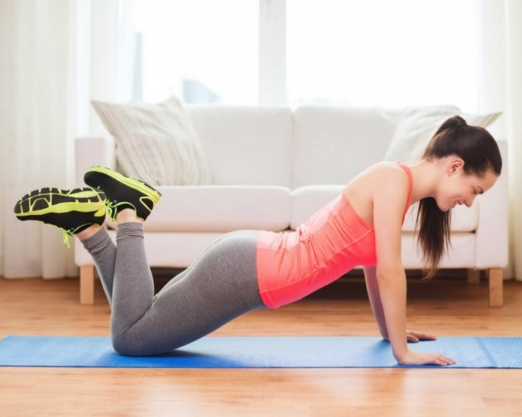Girl Exercising At Home