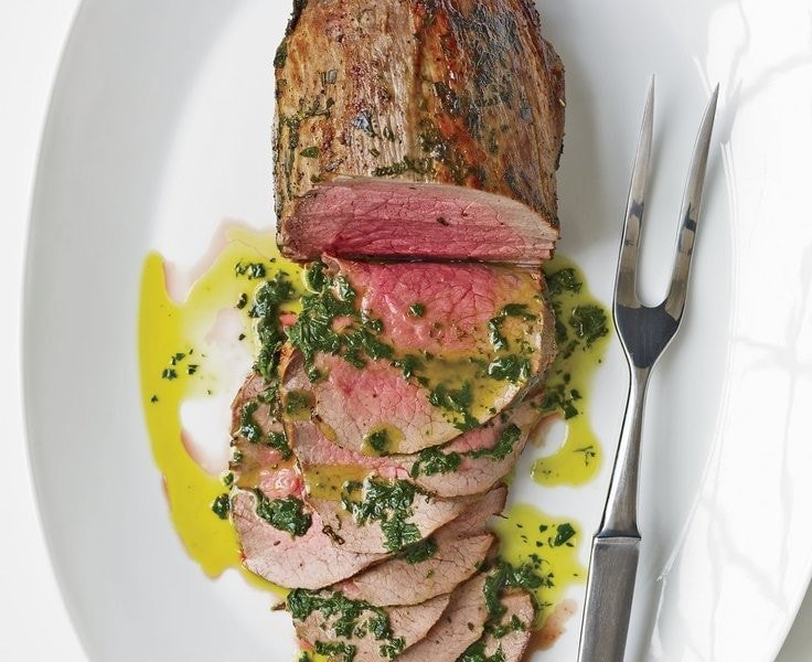 Beef with fresh herbs and basil oil